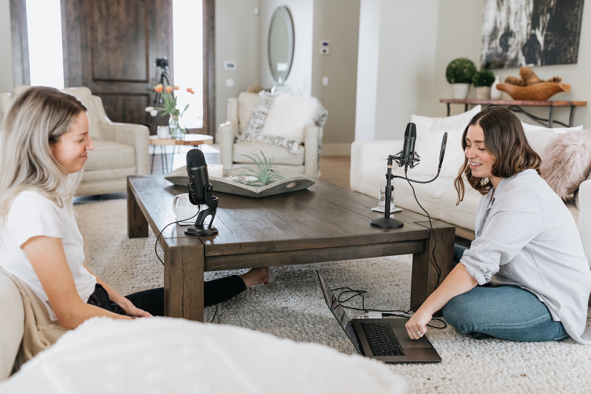 Women recording radio show at home